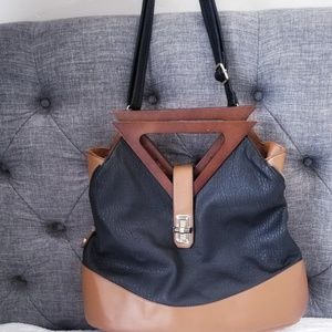 Cute camel and black hand bag